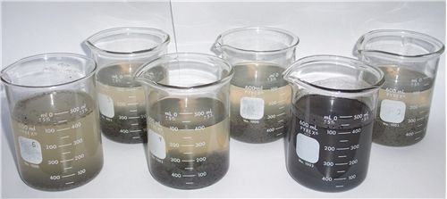 Jar testing Enerco wastewater treatment products.  Look at that floc!